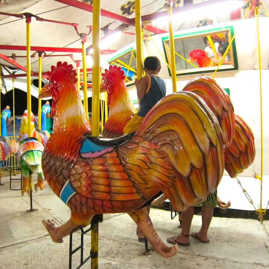 Color game in perya - In Lieu Of Horses This Carousel Has Chickens And Other Birds It Felt Like I Was In The Twilight Zone